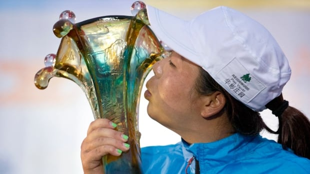 China's Feng Shanshan kisses her trophy after winning the Reignwood LPGA Classic golf tournament at Pine Valley Golf Club on the outskirts of Beijing, China on Sunday.