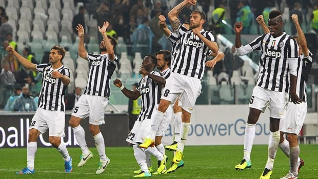 Juventus players celebrate the victory over AC Milan at Juventus Arena on October 6, 2013 in Turin, Italy.