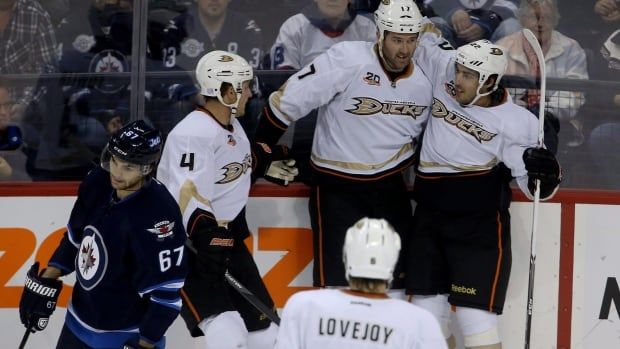 The Anaheim Ducks' Cam Fowler, Andrew Cogliano, Mathieu Perreault and Ben Lovejoy celebrate a goal by Perreault during the first period against the Winnipeg Jets on Sunday at the MTS Centre. The Ducks defeated the Jets 3-2.