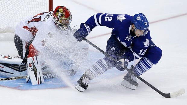Maple Leafs' Mason Raymond scores on Senators goalie Craig Anderson on Saturday night. The Senators and others weren't sure if it should have been a goal, but the NHL clarified the spin-o-rama rule on its website  Sunday night.