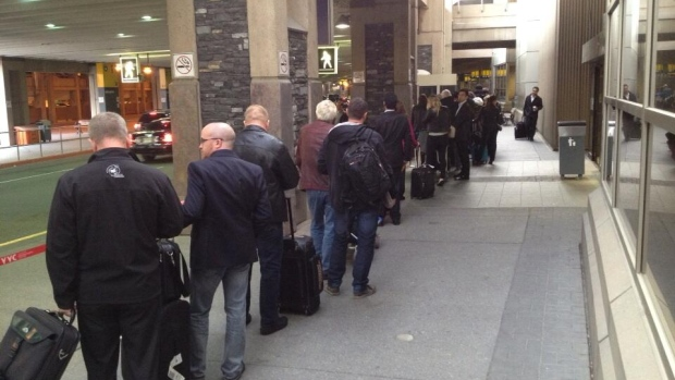 Some passengers say they had to wait in a long lineup for a taxi at the Calgary airport Monday morning, but an airport spokesperson says a 20 minute wait is normal during peak times.