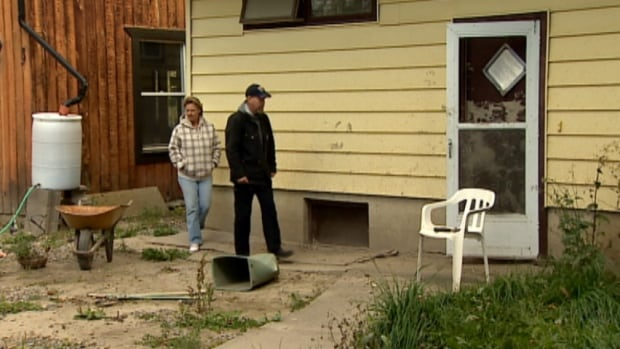 Peggy Smithson and Sean Morrow say the continued uncertainty over whether they can rebuild a flood-damaged home in High River has become unbearable.