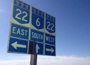 Signs mark Highway 22 north of Regina