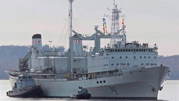 HMCS Preserver, one of Canada's operational support ships, designed to carry large amounts of fuel, provisions, and dry stores during naval operations, is pushed by tugs in Halifax harbour on Wednesday, Oct. 19, 2011.