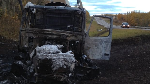 The remains of a semi-tractor trailer sit on Highway 39 one hour southwest of Edmonton after a crash that killed a mother and a young child.