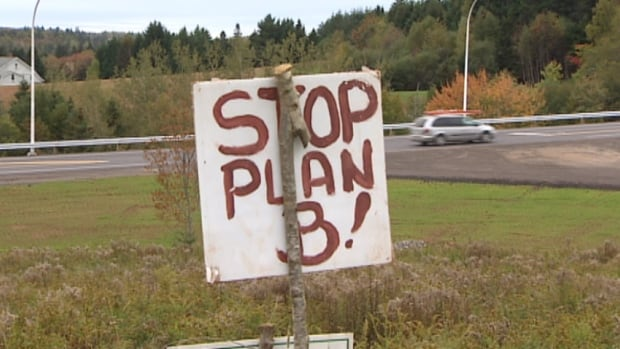 New signs went up protesting the Trans-Canada Highway realignment, despite the fact the project is almost finished.
