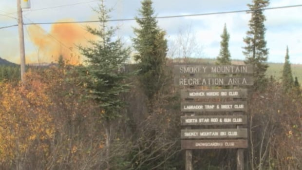A cloud of dust rises up near Smokey Mountain in Labrador City. IOc is blasting in the area, searching for more iron.