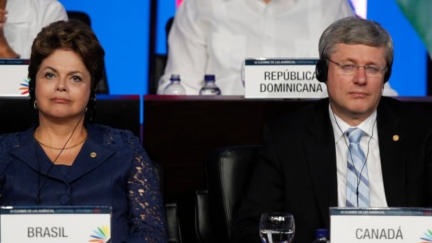 Prime Minister Stephen Harper, seen here with Brazilian President Dilma Rousseff in 2012, may have been left in the dark about spying activities involving Canada and Brazil, one security expert says.