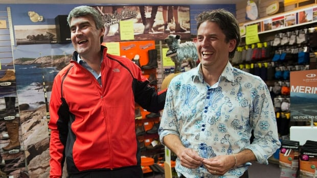 Liberal leader Stephen McNeil campaigns with Joachim Stroink, right. Stronik is one of the new faces elected as part of the Liberal majority Tuesday.