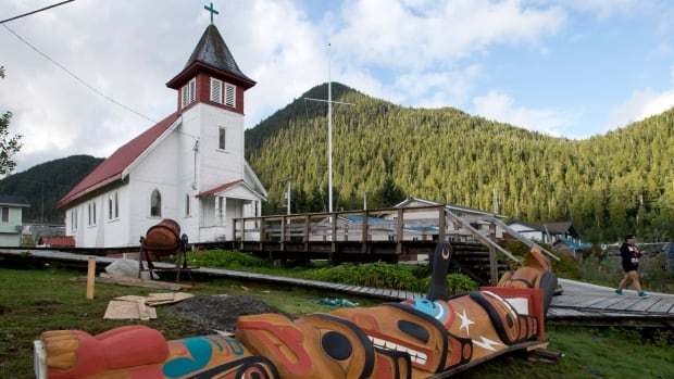 A newly-made totem pole lays on the ground in Hartley Bay, an isolated village on B.C.'s north coast, accessible only by air and water. The Gitga'at of Hartley Bay  say their way of life would be severely threatened by having bitumen-laden oil tankers navigate nearby in Douglas Channel.