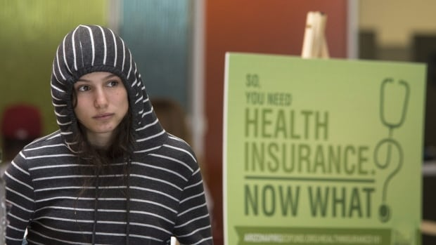 Phoenix College freshman Willow Kanowshy listens during an Affordable Care Act information session held last week after the launch of the online health insurance exchanges. The websites have been plagued with glitches that have prevented some people from signing up.