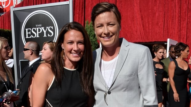 Professional soccer players Abby Wambach, right, and Sarah Huffman were married in Hawaii on Saturday.