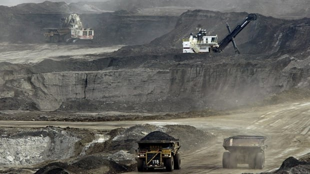 Trucks carry loads of bitumen-soaked sand at Shell's Albian Sands oilsands project near Fort McMurray, Alta., in 2005. The IEA estimates that energy-related carbon emissions rose by five per cent in 2010 from the previous record year in 2008.