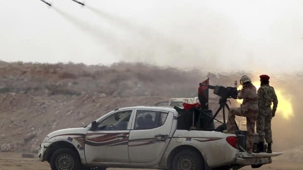 Rebel fighters launch rockets during fighting against Moammar Gadhafi's forces at the frontline along the western entrance to Ajdabiya, Libya.