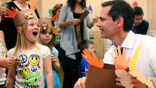 Education is one of the top priorities of Liberal Leader Dalton McGuinty, seen here with Taylor Neuman at Stoney Creek Public School in London in Oct. 2010. (Dave Chidley/Canadian Press)