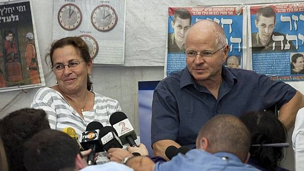 Aviva and Noam Schalit, parents of captured Israeli soldier Gilad Schalit, sit in a protest tent Wednesday outside the prime minister's home in Jerusalem to talk about the coming release of their son.