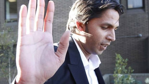Pakistani fast bowler Mohammad Asif leaves the Southwark court in London, Tuesday. Asif and Salman Butt were convicted of fixing parts of a test match against England in August 2010.
