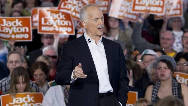 NDP Leader Jack Layton, speaking at a rally in Saskatoon, warns of major service cuts if the Conservatives or Liberals are elected to form a government. Paul Chiasson/Canadian Press