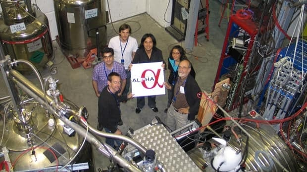 Some of the researchers involved in the discovery are from Canada, including, from left to right, Michael Hayden and Mohammad Ashkezari from Simon Fraser University; Tim Friesen from the University of Calgary; Makoto Fujiwara from TRIUMF; and Andrea Gutierrez and Walter Hardy from the University of British Columbia. They are shown with their experimental setup at the CERN Laboratory near Geneva.