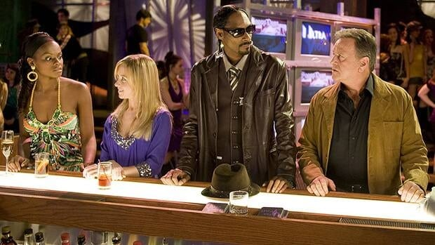 Rapper Snoop Dogg, second from right, is among the fans of One Life to Live and made two appearances on the now-cancelled soap in recent years.