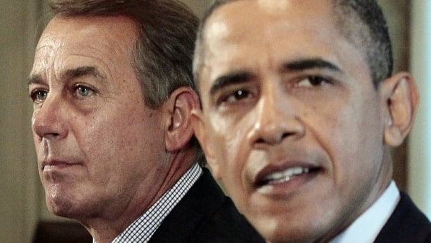 U.S. Republican House Speaker John Boehner, at left, listens as U.S. President Barack Obama speaks during a meeting with Congressional leadership to discuss the debt. Republicans are pushing for a $2-trillion debt reduction package.