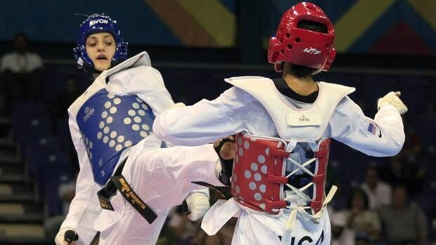 Canada's Melissa Pagnotta, left, and Paige Mcpherson fight during the women's taekwondo -67 kg final match at the Pan American Games in Guadalajara, Mexico on Monday.
