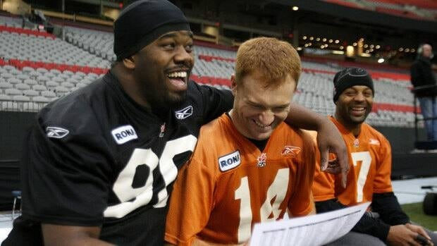 Lions players Aaron Hunt, Travis Lulay and Jarious Jackson share a laugh on the sidelines at their last practice before facing the Blue Bombers in the Grey Cup final.