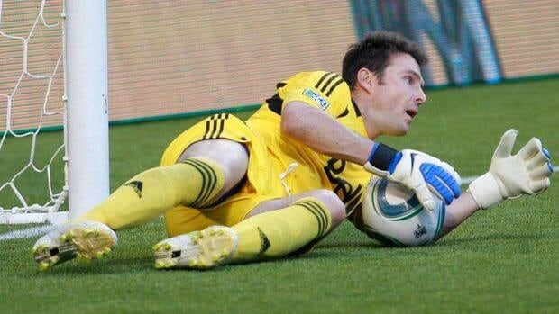 Vancouver FC goalkeeper Joe Cannon makes a save during a game against the Portland Timbers earlier this season. The Whitecaps signed the veteran to an undisclosed deal on Monday.