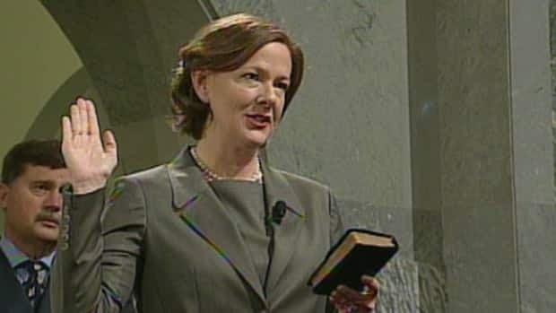 Alison Redford is sworn in as Alberta premier in a ceremony Friday at the Alberta legislature in Edmonton.