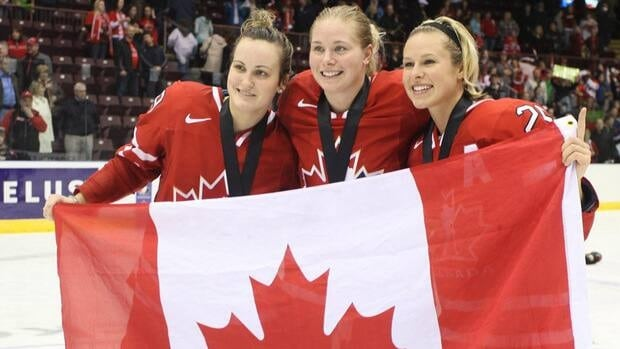 In this photo, Canadians Marie-Philip Poulin, Haley Irwin and Tessa Bonhomme celebrate their overtime win against the U.S. for the gold medal at the Four Nations Cup in St. John's a year ago.