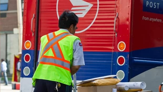 Canada Post says volume at its major centres is still 'very, very heavy' as it works to clear a backlog caused by a recent work stoppage.