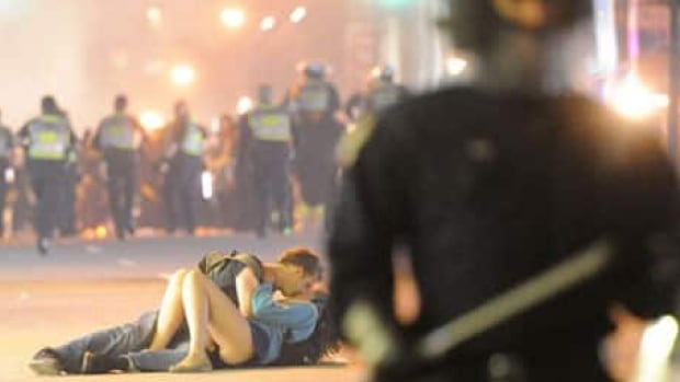 The couple seen in this iconic photo taken during the 2011 Vancouver riot are still together, four years later.