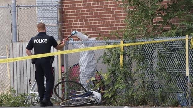 A woman's body was found between a fence and a former Hydro Ottawa building.