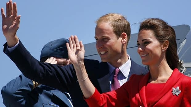 The Duke and Duchess of Cambridge wave from their plane before departing from their cross-Canada tour in Calgary on July 8.