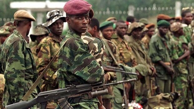 Rebel soldiers line up outside the presidential palace in Kinshasa in 1997 in the former African nation of Zaire, now the Democratic Republic of Congo. That was among several conflicts that ramped up around the world during that El Nino year.