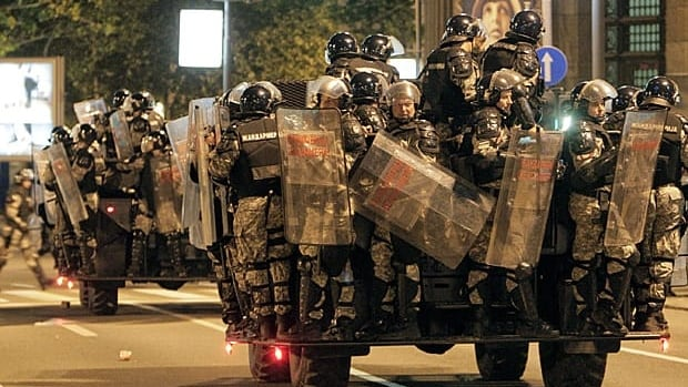 Serbian riot police ride move in during clashes that followed a support rally for war crimes suspect Ratko Mladic in Belgrade on Sunday.