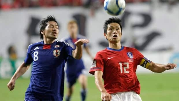 South Korea's Lee Young-pyo, right, fights for the ball against Japan's Daisuke Matsui during a friendly in Seoul last year.