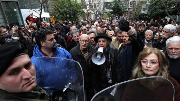 Protesters chant slogans outside the home of former Socialist Prime Minister Costas Simitis, in central Athens, on Thursday, March 3, 2011. Protest organizers argue that former heads of government should be held accountable for the country's serious debt crisis.
