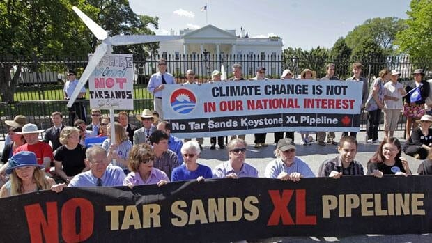 Environmental activists gather outside the White House in Washington, Aug. 22, as they continue a civil disobedience campaign against a proposed oil pipeline from Canada to the U.S. Gulf Coast. Canadian activists are planning a Sept. 26 protest in Ottawa.