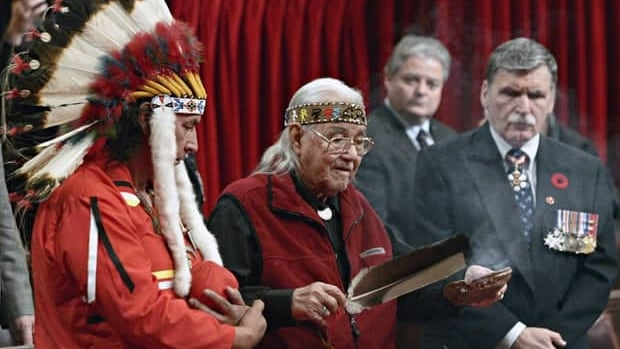 William Commanda, a former chief of the Algonquin nation, died Aug. 3. Commanda (centre) uses sweetgrass during a remembrance ceremony in the Senate chamber on Parliament Hill in Ottawa Nov. 4, 2005. Former Algonquin chief Dominique Rankin and Senator Romeo D'Allaire look on. Tom Hanson/Canadian Press