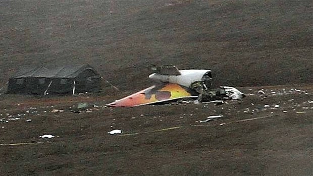 Investigators erected a tent Sunday near the tail section of First Air flight 6560, which crashed in Resolute Bay on Saturday.