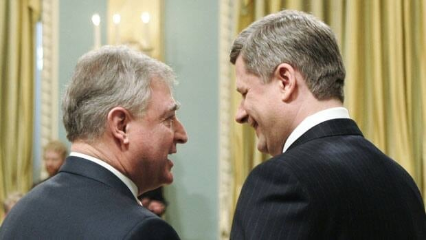 A private member's bill from the NDP that seeks to ban MPs from crossing the floor is being debated Wednesday. David Emerson, left, ditched the Liberals in 2006 to join Prime Minister Stephen Harper's cabinet, prompting outrage from voters.