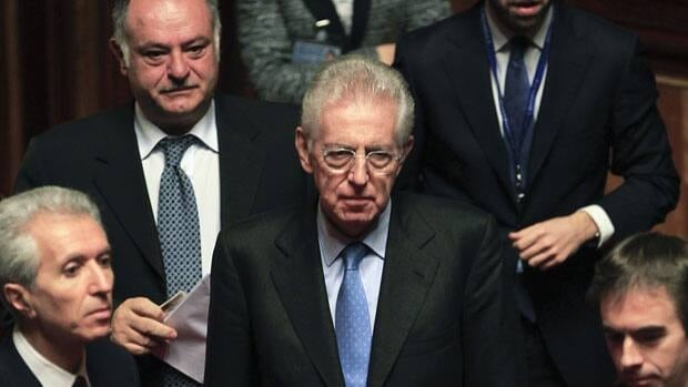 Former European commissioner Mario Monti, centre arrives Friday at the Senate in Rome. Monti emerged on Thursday as favourite to replace Silvio Berlusconi at the head of an emergency government.