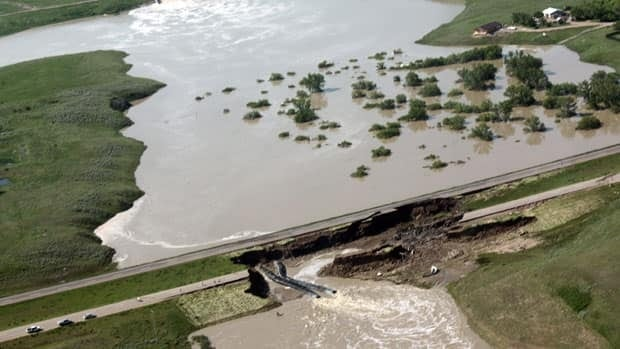 Flooded land and damage to the Trans-Canada Highway near Maple Creek, Sask., can been seen in this aerial photograph from June 20, 2010.