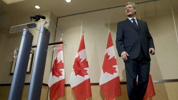 Conservative Leader Stephen Harper stops walking away from the podium as he is asked a question during a media appearance in Calgary on Tuesday. (Adrian Wyld/Canadian Press)