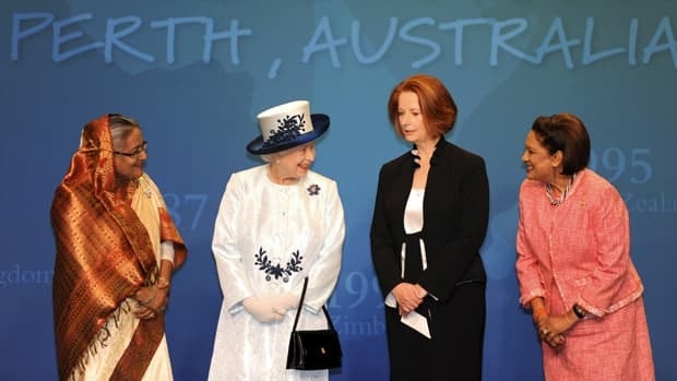 Queen Elizabeth smiles next to Bangladesh's Prime Minister Sheikh Hasina (left), Australia's Prime Minister Julia Gillard, and Trinidad and Tobago's Prime Minister Kamla Persad-Bissessar at the Commonwealth Heads of Government Meeting (CHOGM) in Perth on Friday.