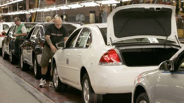 Employees assemble Chevrolet Impalas at GM's assembly plant in Oshawa, Ont.