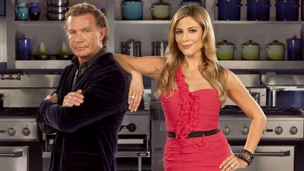 Top Chef Canada head judge Mark McEwan, seen at left, is shown with host Thea Andrews. Chefs will compete to create a dish from scratch from horse meat on Monday night's show.