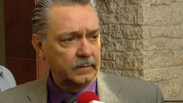 Alberta Health Minister Gene Zwozdesky speaks to reporters after an event at Edmonton City Hall Tuesday.