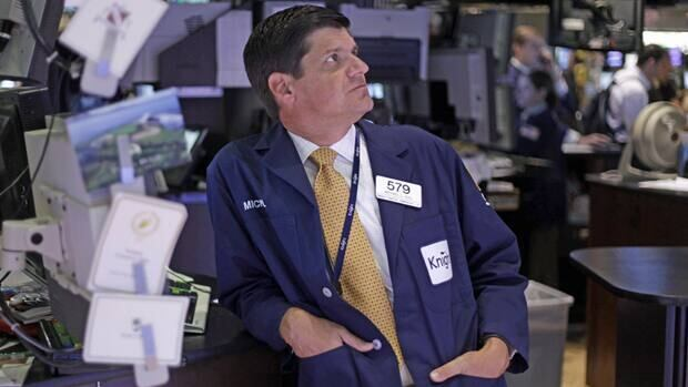 A trader works on the floor at the New York Stock Exchange on Monday. The Dow Jones industrial average lost 151.44 points, or 1.2 per cent, to close at 12,505.76 Monday.